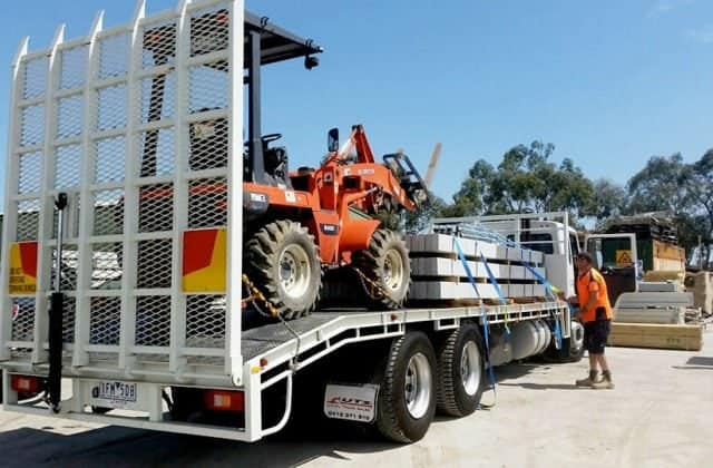 Sunset Sleepers — Loading concrete sleepers for a Melbourne delivery on our all-terrain 14ft rigid truck with our own forklift